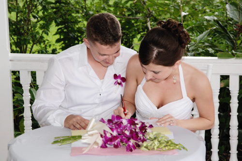 take forty five - airbrush makeup artist - destination wedding in Jamaica bride and groom signing marriage license